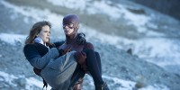 The Flash saves Caitlin from Firestorm's explosion.