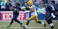 Seattle Seahaws runningback Marshawn Lynch stiffarms Green Bay Packers strong safety Morgan Burnett during a 36-16 Seahawks win over the Packers